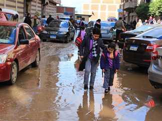 سقوط أمطار في أول أيام الدراسة بالفصل الدراسي الثاني بالغربية، 12 فبراير 2017. - صورة أرشيفية