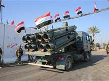 احتفال أعضاء الوحدة العسكرية العراقية، فى الذكرى الأولى لانتصار البلاد على تنظيم الدولة الإسلامية (داعش).