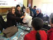 «مستقبل وطن بسوهاج» يوزع ملابس شتوية جديدة وأحذية بالمجان