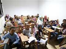 أطفال مدارس اللاجئين فى مصر يعانون من قلة الإمكانات